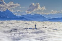 Mont-Gibloux and Alps mountains upon clouds, Stock Photography