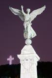 Mont-Kunglig person kors och ängelstaty Arkivfoto