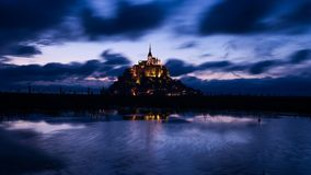 Mont Saint Michael with water reflection during night time  center image Stock Images