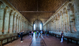 Mont Saint Michel Abbey interior. People in the Interior of the Mont Saint Michel abbey. Normandy, France Royalty Free Stock Photo