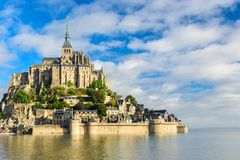 Mont Saint Michel abbey on the island, Normandy, Northern France, Europe. At sunrise royalty free stock photo