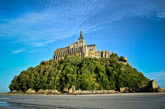 Mont saint michel abbey on a low tide day. Normandy, France Royalty Free Stock Photos