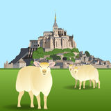 Mont Saint-Michel Abbey and sheep on a pasture Stock Photography