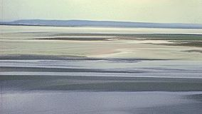 Mont Saint-Michel aerial view. Aerial view of mouth of the Couesnon River top view from Mont Saint-Michel in the 70s. Saint Michael`s Mount Archival from 1976 in stock video