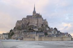 Mont Saint-Michel centered world heritage site low tide clouds beach sand sun history france normandy stock photography