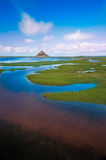 Mont Saint-Michel with clouds at a sunny day, Normandy, France Royalty Free Stock Image