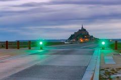 Mont Saint-Michel en la puesta del sol Imagen de archivo libre de regalías