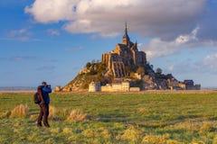 Mont Saint-Michel en la puesta del sol Fotografía de archivo