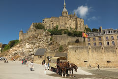 Mont Saint Michel, France - September 8, 2016: Panoramic view of. Famous Le Mont Saint-Michel tidal island on a sunny day with blue sky and clouds, Normandy Stock Photos