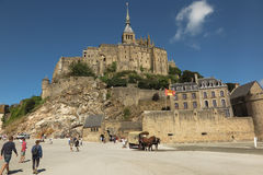 Mont Saint Michel, France - September 8, 2016: Panoramic view of. Famous Le Mont Saint-Michel tidal island on a sunny day with blue sky and clouds, Normandy Stock Photo