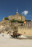 Mont Saint Michel, France - September 8, 2016: Panoramic view of. Famous Le Mont Saint-Michel tidal island on a sunny day with blue sky and clouds, Normandy Royalty Free Stock Image