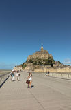 Mont Saint Michel, France - September 8, 2016: Panoramic view of. Famous Le Mont Saint-Michel tidal island on a sunny day with blue sky and clouds, Normandy Royalty Free Stock Photos