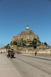 Mont Saint Michel, France - September 8, 2016: Panoramic view of. Famous Le Mont Saint-Michel tidal island on a sunny day with blue sky and clouds, Normandy Royalty Free Stock Photography