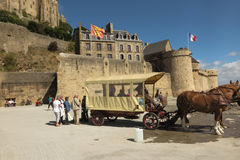 Mont Saint Michel, France - September 8, 2016: Panoramic view of. Famous Le Mont Saint-Michel tidal island on a sunny day with blue sky and clouds, Normandy Stock Photography