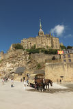 Mont Saint Michel, France - September 8, 2016: Panoramic view of. Famous Le Mont Saint-Michel tidal island on a sunny day with blue sky and clouds, Normandy Royalty Free Stock Images