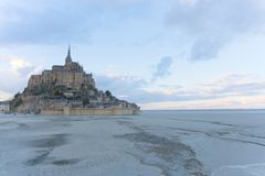 Monastery Mont Saint-Michel at low tide sunset blue twilight abbey sand horizon stock photography