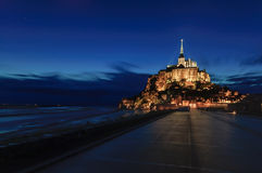 Mont Saint Michel monastery and bay landmark night view. Normandy, France Stock Image