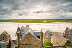 Mont Saint Michel monastery and bay. Normandy, France. Mont Saint Michel monastery landmark and bay in low tide and bad weather. Normandy, France, Europe Stock Images