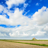 Mont Saint Michel monastery landmark and field. Normandy, France Royalty Free Stock Image