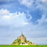 Mont Saint Michel monastery landmark and green field. Normandy, France Royalty Free Stock Photos