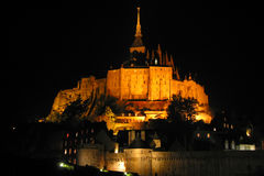 Mont Saint Michel by night. Le Mont Saint Michel by night, with yellow - orange lights, Normandy, France Royalty Free Stock Photography