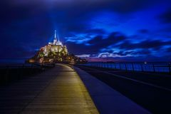 Mont Saint Michel at night with light on the path to the abbey Royalty Free Stock Photos