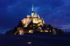 Mont Saint-michel at night lit up from the walkway centered image royalty free stock image