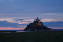 Mont Saint Michel by night. Mont Saint Michel at sunset by night at high tide stock image