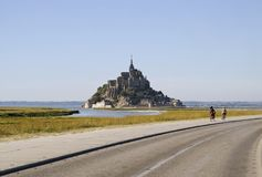 Mont Saint-Michel. Norman Benedictine Abbey of St Michel at the peak of the rocky island, surrounded by the winding streets and convoluted architecture of the Royalty Free Stock Photos