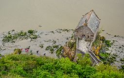 Mont Saint Michel, Normandy, France. Le Mont-Saint-Michel is an island commune in Normandy, France. It is located about one kilometre off the country`s Stock Photo