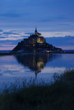 Mont Saint Michel reflection at sunset. At high tide stock images