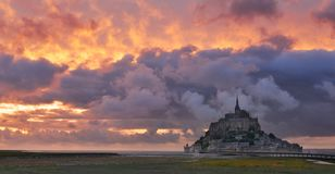 Mont Saint Michel at sunset. Mont Saint Michel at sunset,Normandy,France.Panoramic landscape of famous medieval castle Mont Saint Michel stock photo