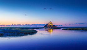 Mont Saint-Michel in twilight at dusk, Normandy, France. Panoramic view of famous Le Mont Saint-Michel tidal island in beautiful twilight during blue hour at Royalty Free Stock Photos