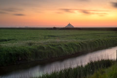 Mont saint-Michel view from meadow Stock Images