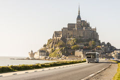 Mont Saint Michele - France, Normandy. MONT SAINT-MICHEL, FRANCE - APRIL 23:Tourist in bus on road to island with UNESCO monastery on april 23, 2013 in Mont stock photos