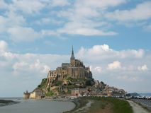 Mont St. Michel. Mont Saint Michel is a small rocky islet in Normandy, roughly one kilometre from the north coast of France at the mouth of the Couesnon River Royalty Free Stock Photo