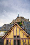 Mont St. Michel abbey. Abbey and traditional houses of Mont St. Michel, France Royalty Free Stock Photo