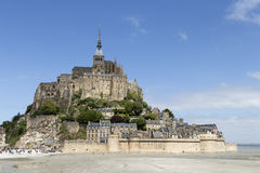 Mont St Michel from distance. A distance photo on Mont St Michel in Normandy France with a blue sky and some clouds stock image