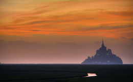 Mont St. Michel, France. English: Saint Michael's Mount) is a rocky tidal island and a commune in Normandy, France. It is located approximately one kilometre ( Royalty Free Stock Image
