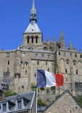 Mont St Michel. In Normandy with the French flag in the foreground Royalty Free Stock Photo