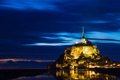 Mont St. Michel reflected in the sea at sunset Royalty Free Stock Image