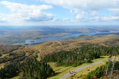 Mont Tremblant with Fall Foliage, Quebec, Canada. Lake Tremblant and Mont-Tremblant village in fall with fall foliage, from top of Mont Tremblant, Quebec, Canada Royalty Free Stock Images