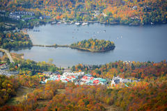 Mont Tremblant with Fall Foliage, Quebec, Canada. Lake Tremblant and Mont-Tremblant village in fall with fall foliage, from top of Mont Tremblant, Quebec, Canada Stock Photos