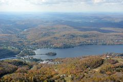 Mont Tremblant with Fall Foliage, Quebec, Canada. Lake Tremblant and Mont-Tremblant village in fall with fall foliage, from top of Mont Tremblant, Quebec, Canada Stock Images