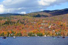 Mont Tremblant with Fall Foliage, Quebec, Canada. Lake Tremblant and Mont-Tremblant village in fall with fall foliage, Town of Mont-Tremblant, Quebec, Canada Royalty Free Stock Photos