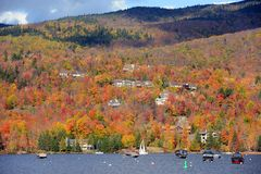 Mont Tremblant with Fall Foliage, Quebec, Canada. Lake Tremblant and Mont-Tremblant village in fall with fall foliage, Town of Mont-Tremblant, Quebec, Canada Royalty Free Stock Image