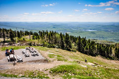 Mont Tremblant Peak, Quebec. View from mountain peak of hiker summiting Mont Tremblant from Mont Tremblant Resort during the summer Royalty Free Stock Photo