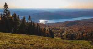 Mont Tremblant Summit. Aerial view of beautiful Lake Tremblant on a sunny day with colorful autumn foliage covering the mountains from the summit of Mont Stock Photography