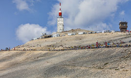 Mont Ventoux- a Cyclist Monument. Mont Ventoux, France- July 14 2013: Fans on the roadside to the top of Mount Ventoux few hours before the apparition of the Royalty Free Stock Images