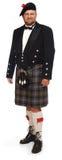 Montañés en falda escocesa en blanco Foto de archivo libre de regalías